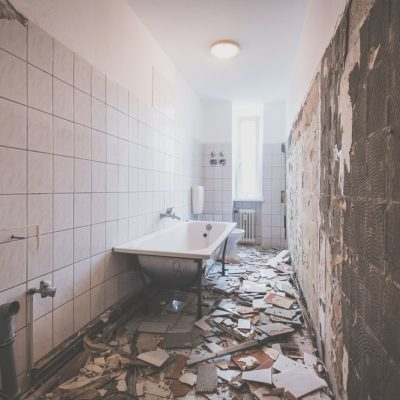 bathroom renovation - removing tiles in old apartment bathroom -